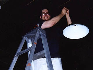 1994 - Serene's husband Chris, working on ceiling lights prior to Carlton opening.